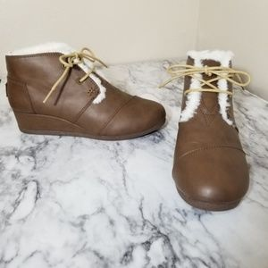 Tom's tan colored fur lined wedge booties